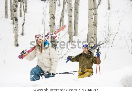 Couple walking with skis over shoulder Stock photo © IS2