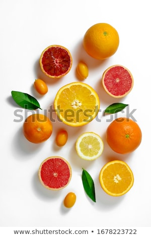 whole and halved limes laying on white background    Stock photo © LightFieldStudios
