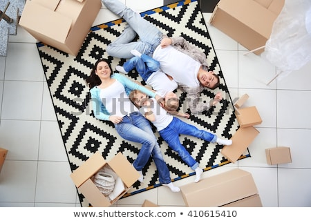 Woman lying on floor with moving boxes Stock photo © IS2