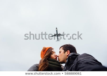 Сток-фото: Young Couples Silhouette And A Storm Landscape