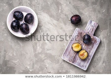 Purple plums on blue wood Stock photo © dash
