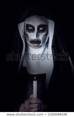 ijesztő · gonosz · apáca · gyertya · közelkép · visel - stock fotó © nito