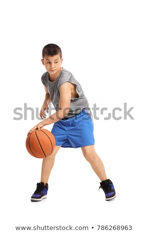 portrait of young sporty men playing basketball at the playgroun stock photo © deandrobot