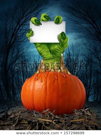 Dynia potwora znak ręką zombie strony latarnia Zdjęcia stock © Lightsource