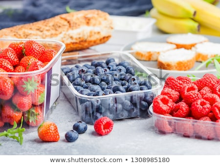 Plastic tray containers of fresh organic healthy beries and bread for fruit sandwiches. Blueberries, stock photo © DenisMArt