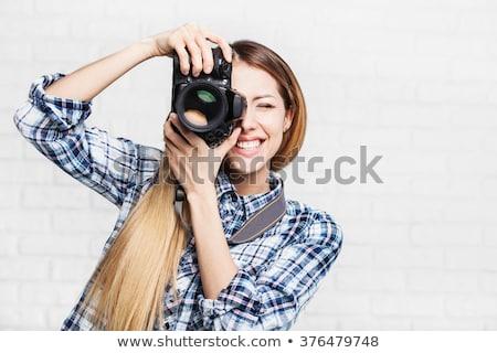 Woman photographer takes images with dslr camera Stock photo © artfotodima
