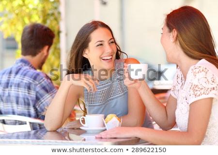 Młodych znajomych mówić inny pitnej kawy Zdjęcia stock © deandrobot