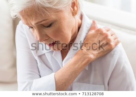 Vrouw lijden schouderpijn achtergrond spier Stockfoto © Kzenon