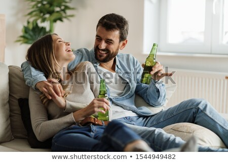 male alcoholic drinking beer at home Stock photo © dolgachov