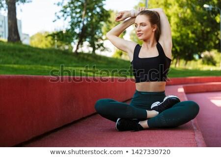 Photo femme de remise en forme 20s survêtement corps Photo stock © deandrobot