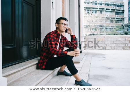 Yandan görünüş gülen Asya erkek öğrenci gözlük Stok fotoğraf © deandrobot