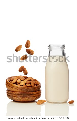 A bottle of almond milk with whole and shelled almonds Stock photo © madeleine_steinbach