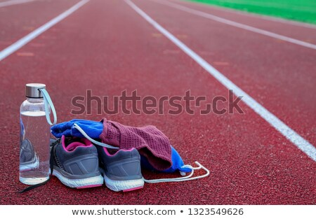 Rucksack and water bottle on athletic track Stock photo © bdspn