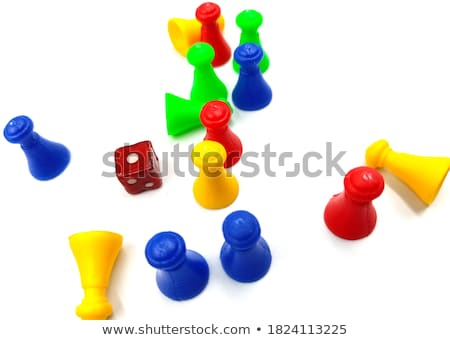 Red And Yellow Wooden Game Pawns On Plain Background Stock photo © AndreyPopov