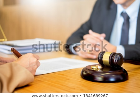 couple problems sitting a marriage Golden wedding rings judge ga Stock photo © snowing