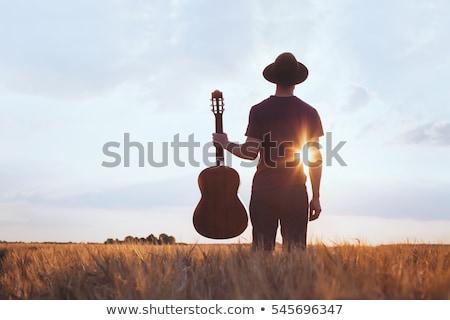 Guitarrista músico silueta detallado jugando guitarra Foto stock © Krisdog