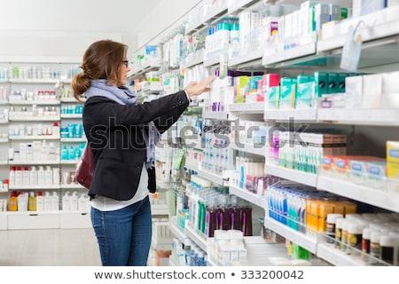Kobiet klienta narkotyków apteki muzyka Zdjęcia stock © dolgachov