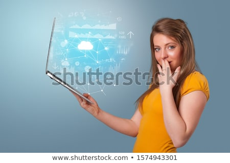 Woman holding laptop with cloud based system concept Stock photo © ra2studio