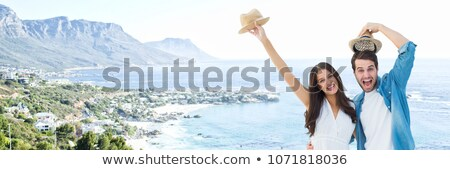 Millennial couple against blurry coastline Stock photo © wavebreak_media