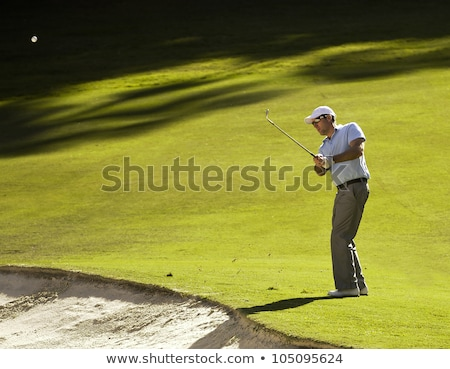 Golfer chipping in bunker. Stock photo © lichtmeister