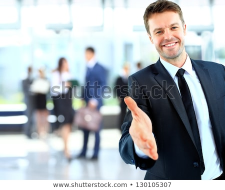 Portrait of friendly businessman giving hand for handshake. stock photo © lichtmeister