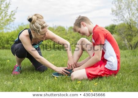 Sportos fiú tart fájdalmas sebesült boka Stock fotó © Lopolo