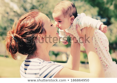 Mother and baby relaxing in the park Stock photo © Lopolo