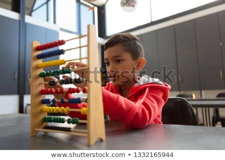 Fronte view cute scolaro apprendimento matematica Foto d'archivio © wavebreak_media