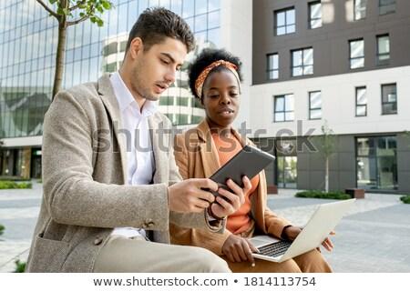 Successful businesswoman using digital tablet while preparing presentation Stock photo © pressmaster