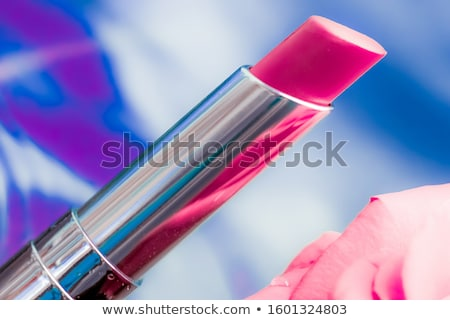 Pink lipstick and rose flower on liquid background, waterproof g Stock photo © Anneleven