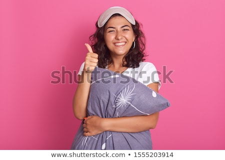 woman with pillow in pajama showing thumbs up Stock photo © dolgachov