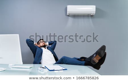 Businessman Enjoying The Cooling Of Air Conditioner Stock photo © AndreyPopov