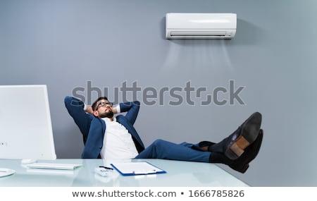 Biznesmen chłodzenie klimatyzator biuro Zdjęcia stock © AndreyPopov
