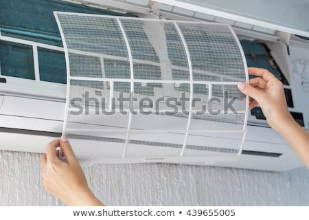 Female worker cleaning and repairing air condition equipment Stock photo © simazoran