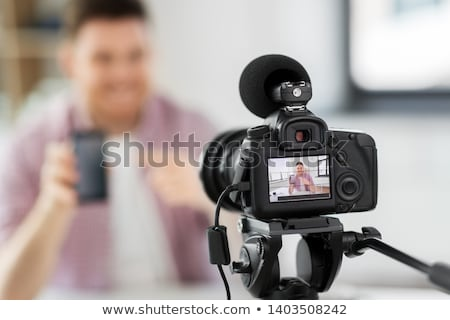 Stock photo: Male Blogger With Smartphone Videoblogging At Home