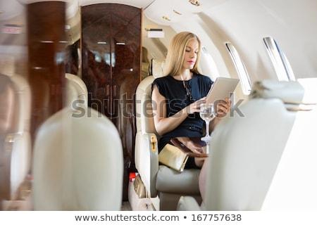 Első osztály üzleti út gyönyörű fiatal nő fiatal szőke nő Stock fotó © darrinhenry