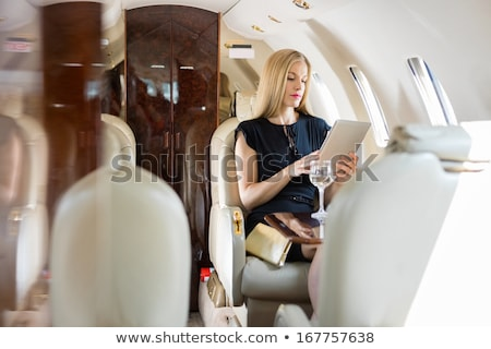 first class business travel beautiful young woman stock photo © darrinhenry
