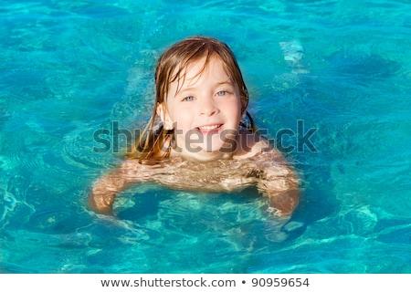 blond little girl portrait in Ibiza beach stock photo © lunamarina