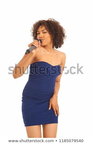 Female singing into mic. Stock photo © iofoto