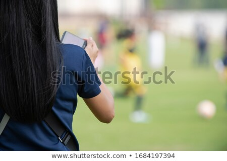 mother watching her child playing stock photo © photography33