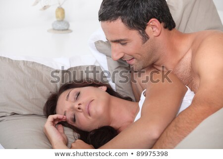 Man waking up his cranky wife Stock photo © photography33