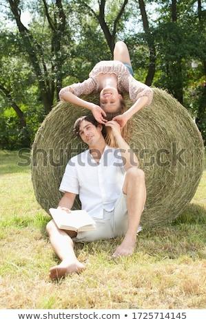 Pár ül széna bála mosoly szeretet Stock fotó © photography33