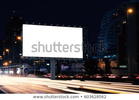 Reclame billboard groene veld hemel landschap Stockfoto © dengess
