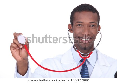 Smiling doctor holding aloft his stethoscope Stock photo © photography33