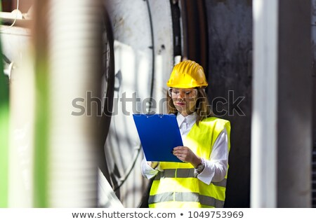 Woman in a hardhat with a clipboard Stock photo © photography33