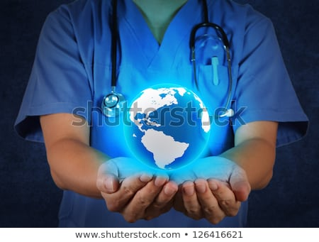 HOLDING, STETHOSCOPE  ON GLOBE Stock photo © photography33