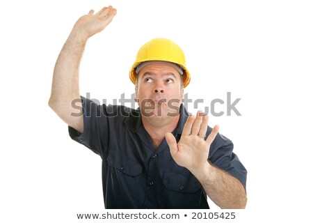 A male construction  worker trapped in an invisible box. Stock photo © photography33