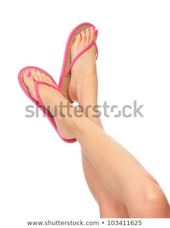 Female legs with flip-flops, isolated on white background.  Stock photo © Nobilior