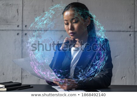 Businesswoman contemplating a globe Stock photo © photography33