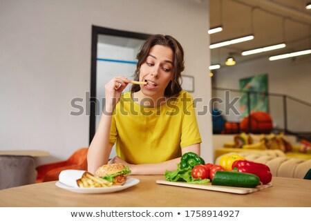 mulher · jovem · pepino · feliz · cozinha · salada - foto stock © Rob_Stark